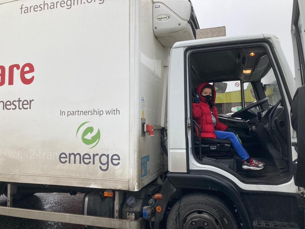 Caleb Waterhouse gets a look from inside the FareShare GM delivery van